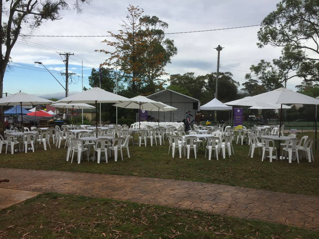 Market umbrellas blow moulded round tables white plastic chairs